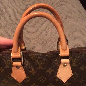 Louis Vuitton Alma Handbag